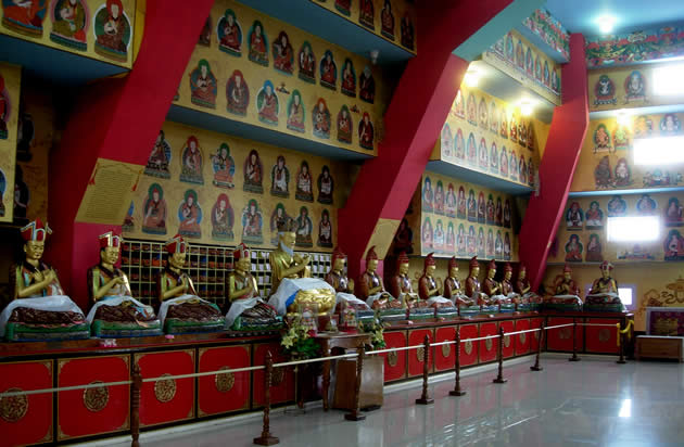 The Lineage Shrine Room in the Great Stupa at Mindrolling Monastery. Terdag Lingpa is the central figure flanked by trichens (left) and khenchens (right))